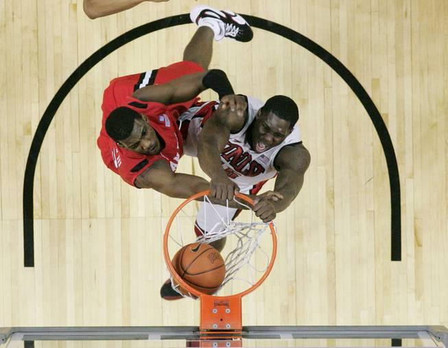 UNLV forward Anthony Bennett dunks on San Diego State forward Winston Shepard during their game Saturday, Feb. 16, 2013. UNLV won the game 72-70 to sweep the regular season series.