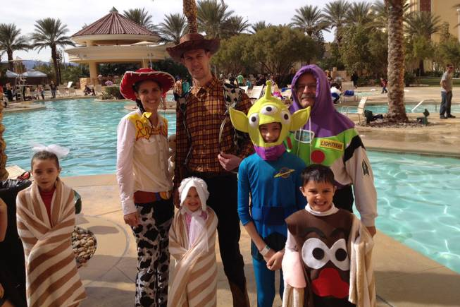 The Reid family poses in Toy Story costumes after plunging into the South Point pool for the Special Olympics Nevada Polar Bear Plunge on Saturday, Feb. 16, 2013. The family members were among more than 150 participants at the fundraiser event.