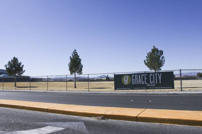 A Grace City Church banner hangs on the Jack Schofield Middle playground fence, Sunday, Feb. 17, 2013. The new Las Vegas church rents out the Jack Schofield Middle School auditorium as a temporary venue to hold they're Sunday services.