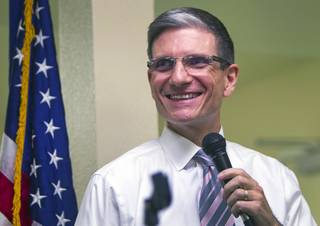 Congressman Joe Heck, R-Nev., smiles as someone's ringtone plays George Thorogood's