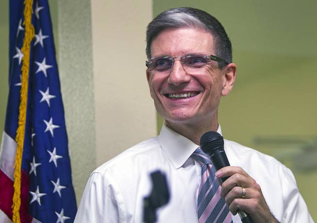 "Congressman Joe Heck, R-Nev., smiles as someone's ringtone plays George Thorogood's ""Bad to the Bone"" during a town hall meeting with constituents at Pacific Pines Senior Apartments in Henderson on Tuesday, Feb. 19, 2013."