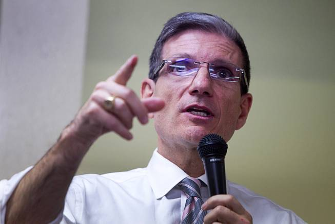 Congressman Joe Heck (R-NV) debates a point with a questioner during a town hall meeting with constituents at Pacific Pines Senior Apartments in Henderson Tuesday, Feb.19, 2013.