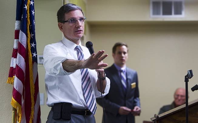 Congressman Joe Heck (R-NV) tries to respond to argumentative questioner during a town hall meeting with constituents at Pacific Pines Senior Apartments in Henderson Tuesday, Feb.19, 2013.