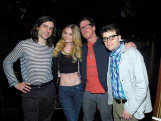 Actress Lydia Hearst poses with members of Weezer during an AG Jeans-hosted private event at Haze in Aria on Tuesday, Feb. 19, 2013.