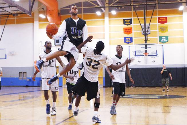 Desert Pines Julian Jacobs drives to the basket during practice Tuesday, Feb. 19, 2013.