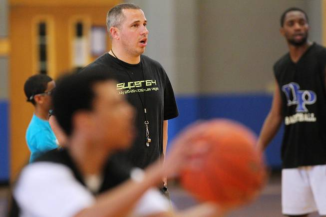 Desert Pines coach Mike Uzan directs his players during practice Tuesday, Feb. 19, 2013.