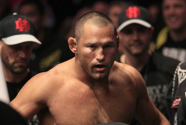 Dan Henderson, center, is shown before a UFC 139 Mixed Martial Arts light heavyweight bout against Mauricio Rua in San Jose, Calif., Saturday, Nov. 19, 2011.