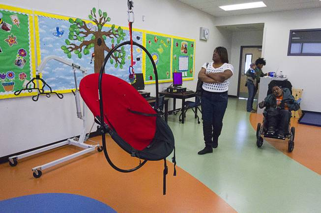 Catrina Parker looks over her son's classroom following an official opening ceremony at the new John F. Miller School, a school which serves students with disabilities and special needs, Wednesday Feb. 20, 2013. The school has been nominated for a national design award.