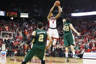 UNLV guard Anthony Marshall takes his game winning shot over the top of Colorado State guard Dorian Green during their Mountain West Conference game Wednesday, Feb. 20, 2013 at the Thomas & Mack. UNLV won 61-59.