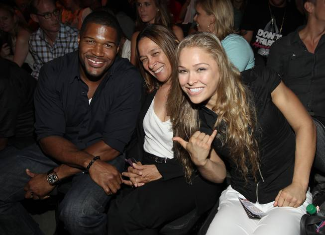 Ronda Rousey, right, poses with Michael Strahan and her mother AnnMaria De Mars at UFC on Fox 4 at Staples Center on Saturday, Aug. 4, 2012, in Los Angeles.