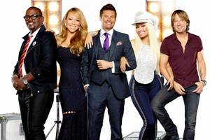 """American Idol"" host Ryan Seacrest is flanked by judges Randy Jackson, Mariah Carey, Nicki Minaj and Keith Urban."