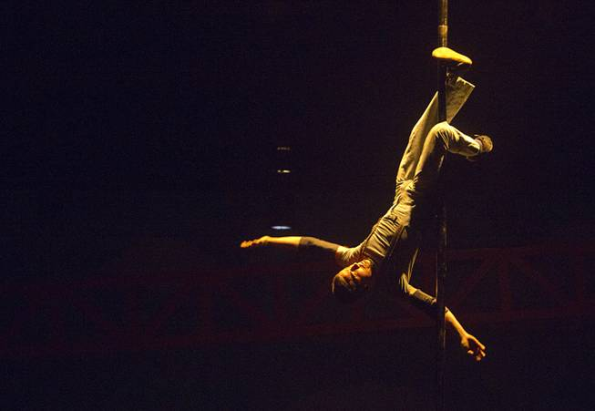 Circus Oz performer Chad Abinger hangs from a pole during a rehearsal at the Smith Center for the Performing Arts Thursday, Feb. 210, 2013. The Australian-based troupe will be performing at the Smith Center Thursday through Saturday.