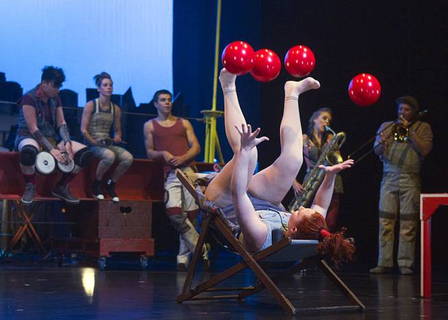 Circus Oz performer Hazel Bock juggles balls with her hands and feet during a rehearsal at the Smith Center for the Performing Arts Thursday, Feb. 210, 2013. The Australian-based troupe will be performing at the Smith Center Thursday through Saturday.