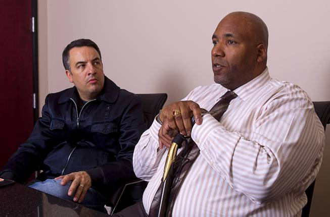 Rudy Gibson talks about his younger brother Stanley during an interview in his attorney's office in Henderson Thursday, Feb. 21, 2013. Attorney Andre Lagomarsino listens at left. Stanley Gibson was killed in an officer-involved shooting in December of 2011.