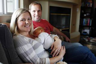 Lisa and Brent Stark sit with their newborn Will Thursday, Feb. 21, 2013. Lisa had Will's placenta dried and turned into pill form for her to take to avoid postpartum depression.