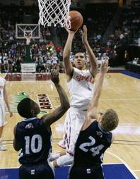 Bishop Gorman's Chase Jeter shoots over Centennial's Marcus Allen (10) and Austin Turley (24) during their Division I state championship game Friday, Feb. 22, 2013 at the Orleans. Gorman won 69-43.
