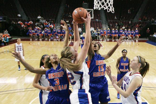 Bishop Gorman's April Rivers, left, and Maddison Washington challenge Reno's Morgan McGwire for a rebound during their Division I state championship game Friday, Feb. 22, 2013 at the Orleans. Reno won 52-39.