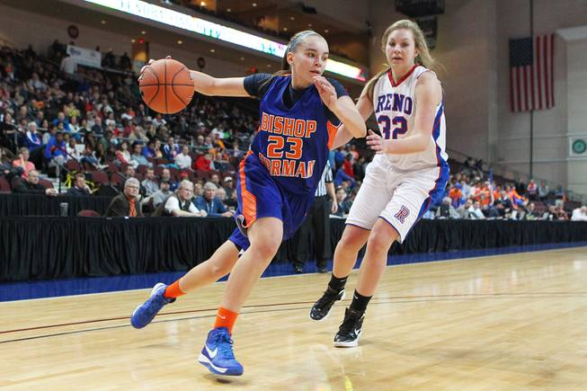 Bishop Gorman's Megan Jacobs makes her move to the basket past Reno's Morgan McGwire during their Division I state championship game Friday, Feb. 22, 2013 at the Orleans. Reno won 52-39.