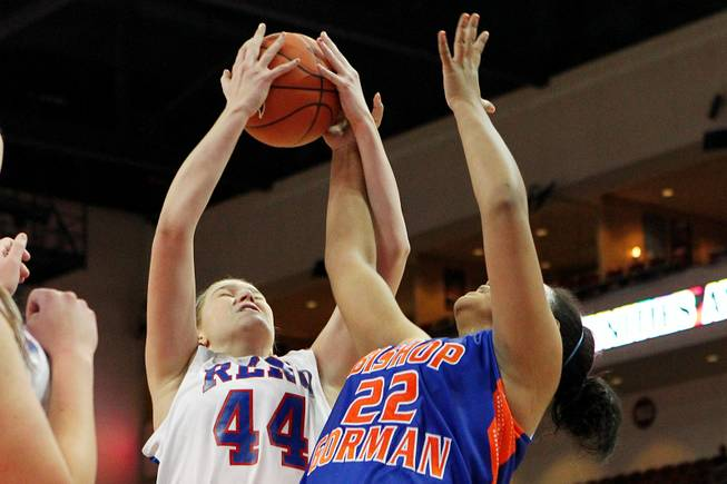 Bishop Gorman's Raychel Stanley and Reno's Mallory McGwire contest a rebound during their Division I state championship game Friday, Feb. 22, 2013 at the Orleans. Reno won 52-39.
