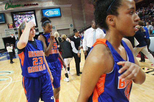 Bishop Gorman's Megan Jacobs, left, Madison Washington and Alaysia Robinson, right exit the court after losing 52-39 to Reno in their Division I state championship game Friday, Feb. 22, 2013 at the Orleans.