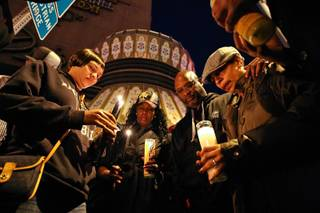 Heidi and Kenneth Cherry Sr. (from right) join friends and family in prayer during a vigil held for their son, Kenneth Cherry Jr., at the corner of Flamingo Road and Las Vegas Boulevard Friday night, February 22, in Las Vegas.