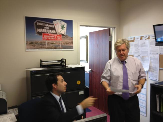 "Sen. Tick Segerblom, D-Las Vegas, passes an aide in his office. In the background is a poster from ""Fear and Loathing in Las Vegas."""