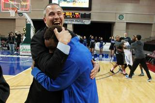 Desert Pines head coach Mike Uzan hugs Terrell Moore after they beat Clark in their Class 1A basketball championship game Saturday, Feb. 23, 2013 at the Orleans Arena. After trailing almost the whole game, Desert Pines came from behind to win 59-57