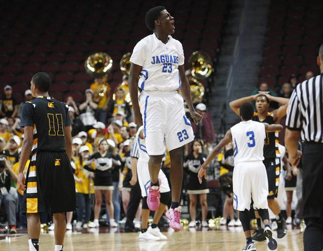Desert Pines Rameek Keith jumps in the air as the Jaguars finally hold a lead over Clark during their Class 1A basketball championship game Saturday, Feb. 23, 2013 at the Orleans Arena. After trailing almost the whole game, Desert Pines came from behind to win 59-57
