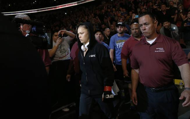Ronda Rousey arrives for her UFC 157 women's bantamweight championship mixed martial arts match against Liz Carmouche in Anaheim, Calif., Saturday, Feb. 23, 2013. Rousey won the first womens bout in UFC history, forcing Carmouche to tap out in the first round. (AP Photo/Jae C. Hong)