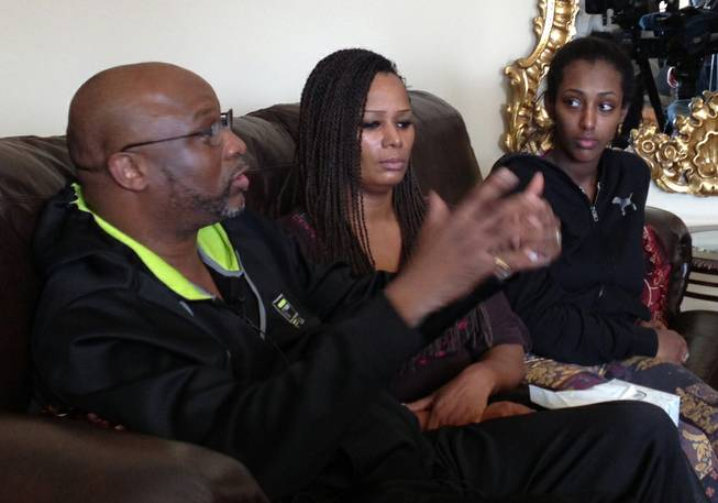 Kenneth Cherry Sr. talks about the life of his son, Kenneth Cherry Jr., with his sister Becky Cherry, center, and his son's girlfriend, May Hagos, in a press gathering at the Turnberry Towers on Saturday, Feb. 23, 2013. Cherry Jr. was shot and killed while driving his Maserati on the Strip after a verbal altercation at the Aria valet area Thursday morning.