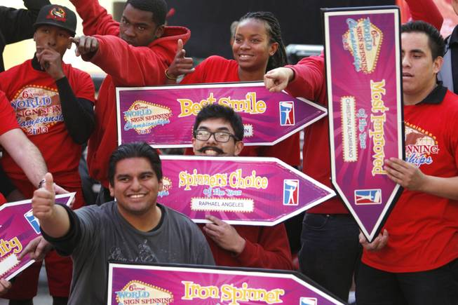 Winners of different categories pose with their signs at the AArrow Sign Spinning company's championship Saturday, Feb. 23, 2013 at the Fremont Street Experience.