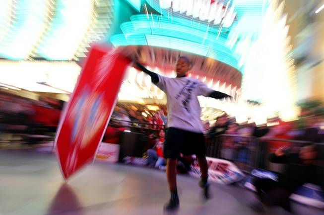Teddy Hale competes at the AArrow Sign Spinning company's championship Saturday, Feb. 23, 2013 at the Fremont Street Experience.