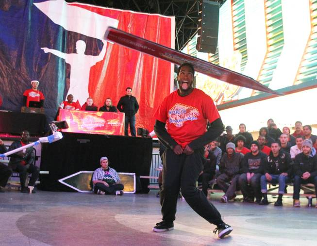 Kadeem Johnson competes at the AArrow Sign Spinning company's championship Saturday, Feb. 23, 2013 at the Fremont Street Experience.
