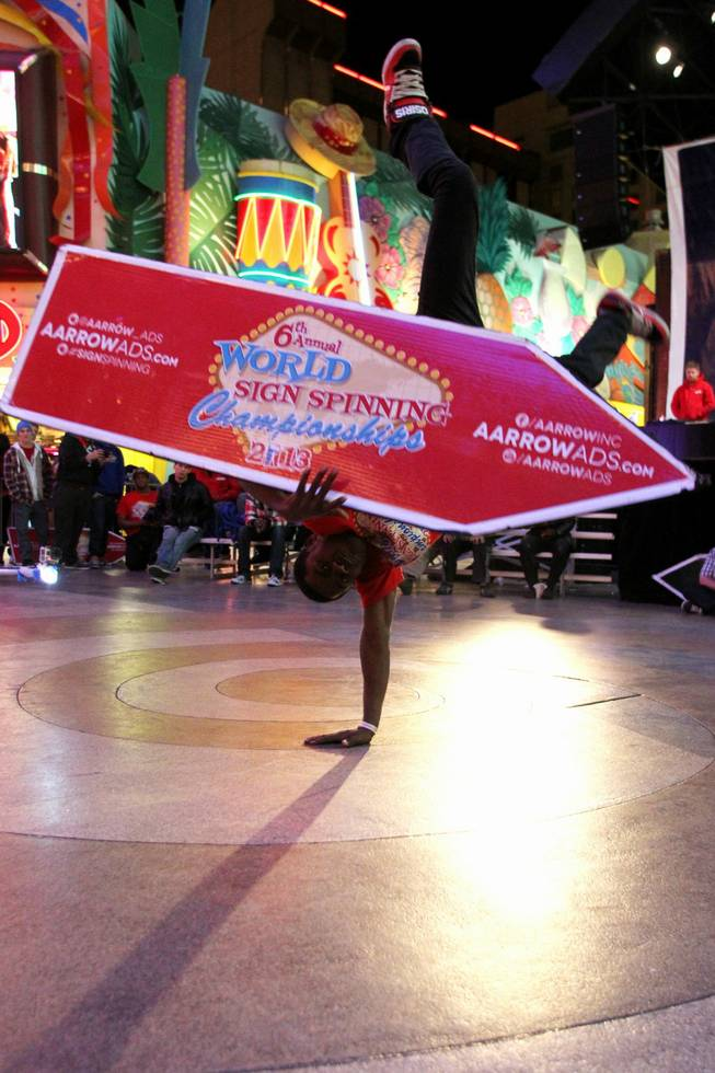 Theo Davis competes at the AArrow Sign Spinning company's championship Saturday, Feb. 23, 2013 at the Fremont Street Experience.
