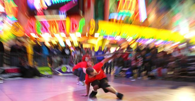 Caleb Jordan competes at the AArrow Sign Spinning company's championship Saturday, Feb. 23, 2013 at the Fremont Street Experience.