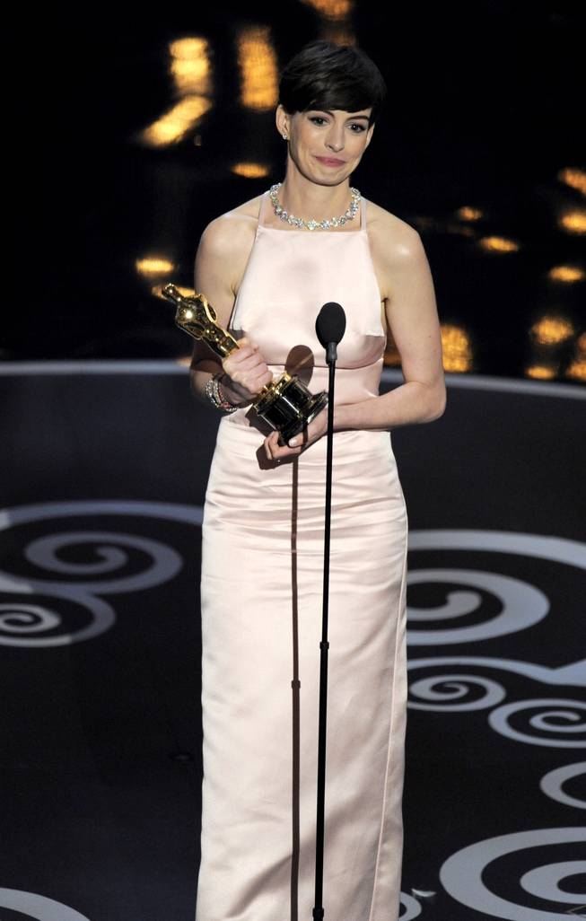 "Anne Hathaway accepts the award for Best Actress in a Supporting Role for ""Les Miserables"" during the Oscars at the Dolby Theater on Sunday, Feb. 24, 2013, in Hollywood."