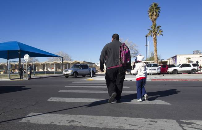 A father and daughter head to school following a rally for Education Awareness Day at Fay Herron Elementary School in North Las Vegas Monday Feb. 25, 2013. Teachers and members of the Clark County Education Association urged lawmakers in Carson City to consider issues with overcrowded classrooms and resources for English language learners. Over 95percent  of the student population at the school is Hispanic, the principal said.