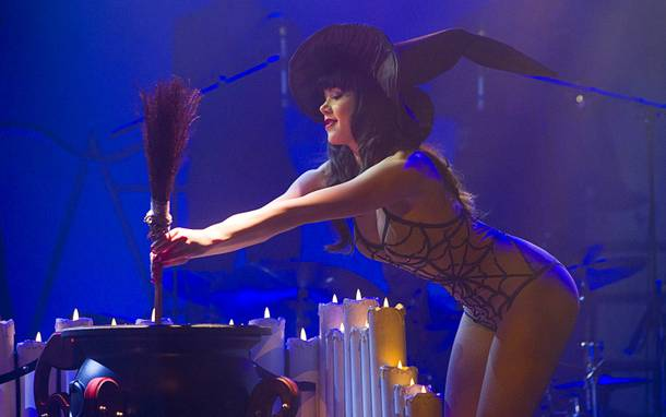 Claire Sinclair, Playboy's 2011 Playmate of the Year, stirs her cauldron during in an October-themed sequence during a media preview of