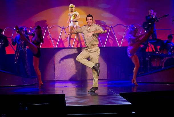 Ryan Kelsey and female dancers perform during a media preview of