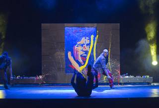 Performance painter David Garibaldi, right, rehearses for