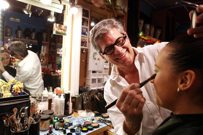 "Roger Stricker, the wigs and makeup supervisor at ""Zumanity,"" tests the ""One Night for One Drop"" makeup for performer Gyulnara Karaeva inside the ""Zumanity"" hair and makeup room at New York New York Hotel & Casino in Las Vegas on Tuesday, February 26, 2013."