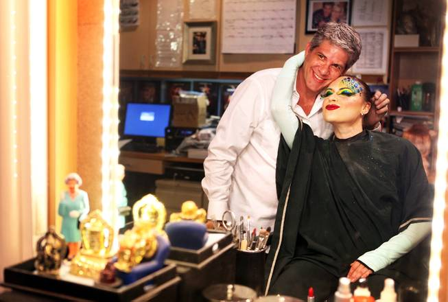 "Roger Stricker, the wigs and makeup supervisor at ""Zumanity,"" gets a hug after testing the ""One Night for One Drop"" makeup on performer Gyulnara Karaeva inside the ""Zumanity"" hair and makeup room at New York New York Hotel & Casino in Las Vegas on Tuesday, February 26, 2013."