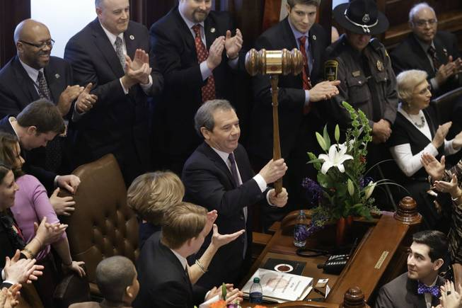 Illinois Senate President John Cullerton, D-Chicago, left, holds up an oversized gavel given to him by Sen. Martin Sandoval, D-Cicero, during swearing-in ceremonies on Senate floor at the Illinois State Capitol Wednesday, Jan. 9, 2013, in Springfield Ill.