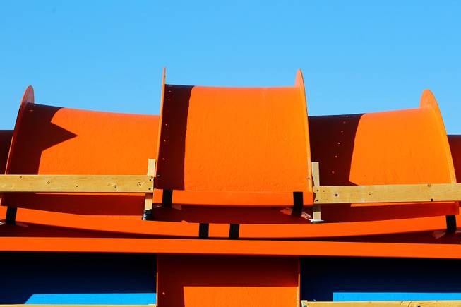 Pieces of water slides wait to be assembeled for the new Wet 'n' Wild water park Wednesday, Feb. 27, 2013.