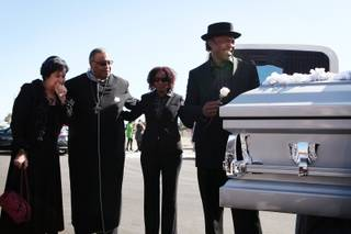 Tehran Boldon, right, Michael Boldon's brother, says goodbye to his brother's coffin after the memorial service for Michael Boldon at Holy Trinity AME Church in North Las Vegas on Wednesday, Feb. 27, 2013. Boldon was killed in his cab Feb. 21, the result of a fiery crash after a shootout on the Las Vegas Strip.
