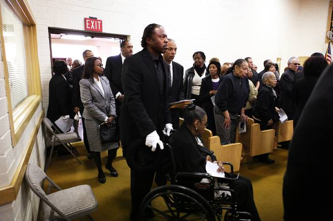 Family members of Michael Boldon enter the church before the memorial service for Michael Boldon at Holy Trinity AME Church in North Las Vegas on Wednesday, Feb. 27, 2013. Boldon was killed in his cab Feb. 21, the result of a fiery crash after a shootout on the Las Vegas Strip.