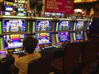 A player tries out the new My Poker video poker line from WMS at Red Rock in February 7, 2013.