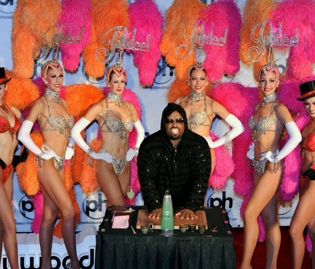 CeeLo Green is surrounded by showgirls from