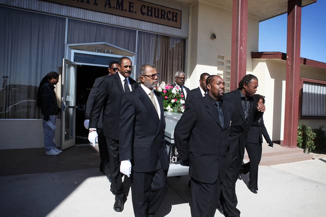 Pallbearers carry the coffin out of the church after the memorial service for Michael Boldon at Holy Trinity AME Church in North Las Vegas on Wednesday, Feb. 27, 2013. Boldon was killed in his cab Feb. 21, the result of a fiery crash after a shootout on the Las Vegas Strip.