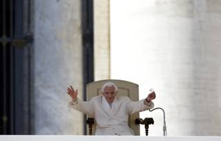 Pope Benedict XVI waves to faithful during his final general audience in St.Peter's Square at the Vatican, Wednesday, Feb. 27, 2013. Pope Benedict XVI has recalled moments of